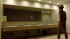 Naughty Asian stroking his cock in a public restroom