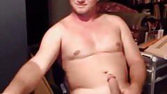 Sexy hunk guy stroking