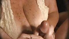 Handjob with cum on huge cleavage