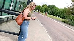 Jeans teen waiting for bus