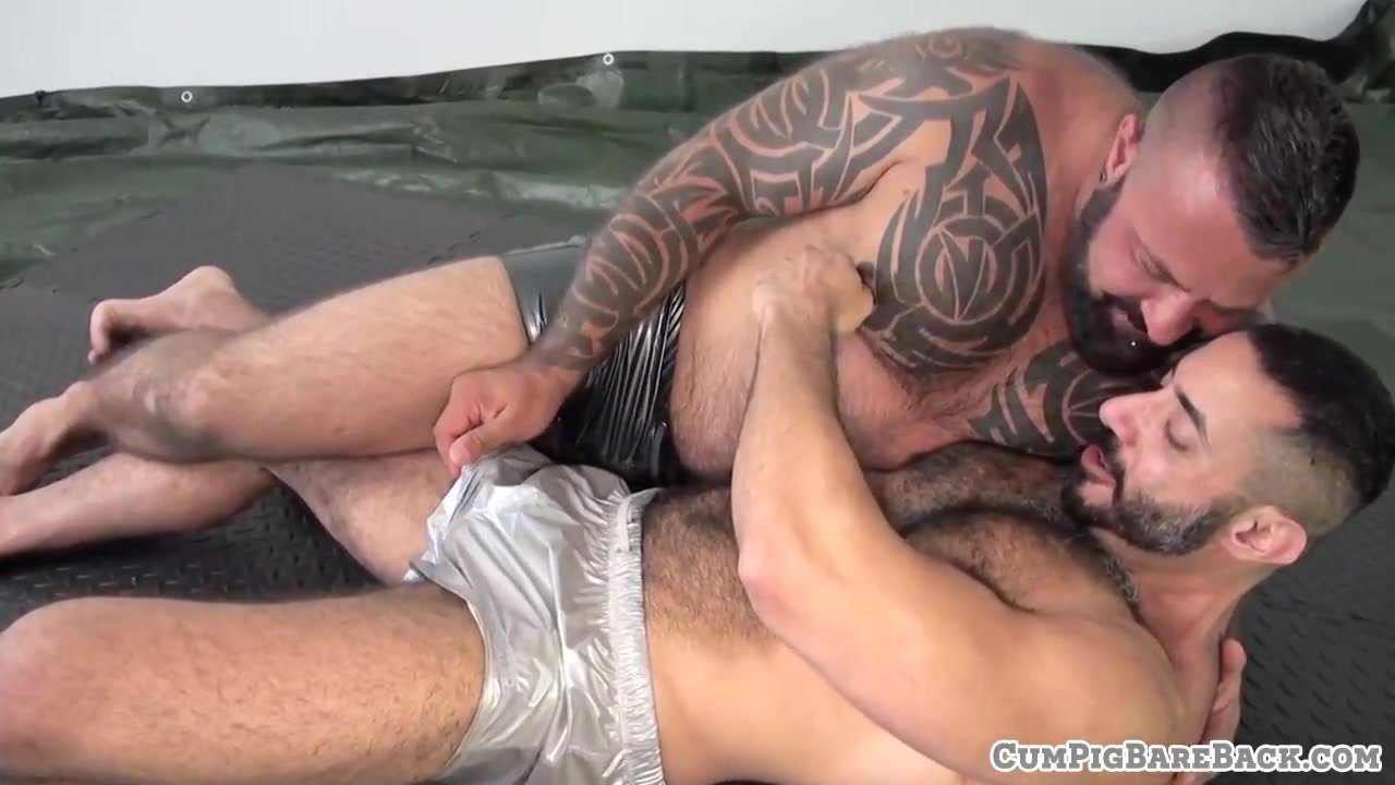 Tattooed bear barebacking twink doggystyle