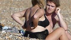 Girl change bra on the beach