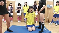 Sexy teen is on her knees sucking two cocks for the team