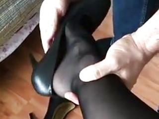 I put the shoes on her feet in black nylon