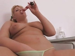 fatty blonde is masturbating her shaved hole