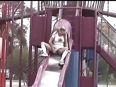Hot blonde with large pussy lips upskirt peeing over a slide Thumbnail