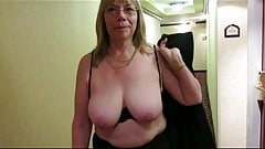 Granny Reba tits out in a hotel hallway.