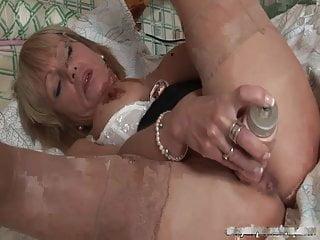 Sexy mature pornstar Jane Bond has fun with her dildo