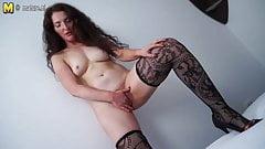 Beautiful MILF masturbating on bed