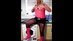 Chrissie smokes in the kitchen in her new pink corest
