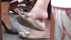 Candid Feet Shoeplay Flats Dangling at Outdoor Cafe