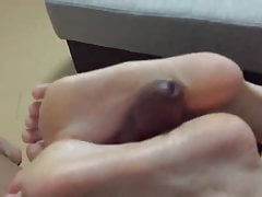 timid footjob while watching anime