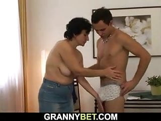 Old woman sucks and rides young cock
