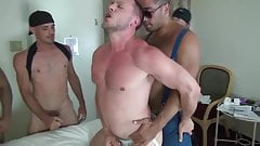 Muscle Bottom Gets Gangbanged in Hotel Room