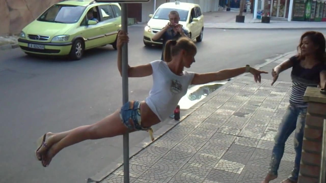Hot Russian girls dancing on a street sign