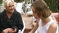 Blonde MILF licks schoolgirl's pussy while schoolgirl fondles her perky tits