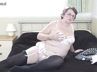 Real grandma plays with her old cunt