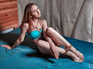 Jute tied ankles and teasing in blue