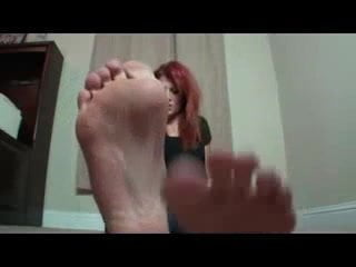 Teen shows her feet in flip flop