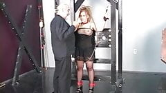 Freaky petite girl in lingerie with dreadlocks is restrained in sex dungeon