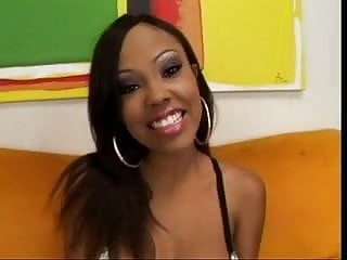 Porn star Lacey Duvalle wraps her pretty mouth around a thick cock