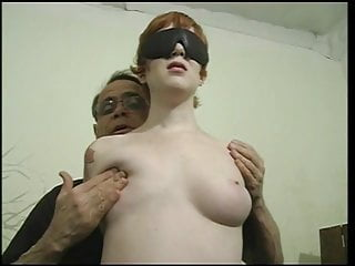 Cute whore with a nice rack gets her boobs squeezed by her master