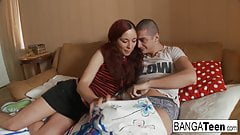 Redhead teen takes a hard cock in bed