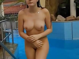 beautiful girl getting out of the pool a little shy