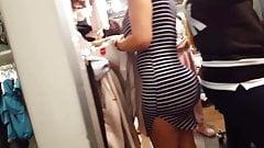 Candid voyeur milf in tight dress shopping