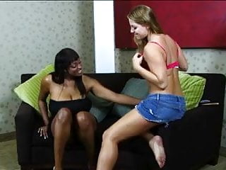 Preview 2 of Horny big tits black and white lesbian babes on couch dildo fucking each other