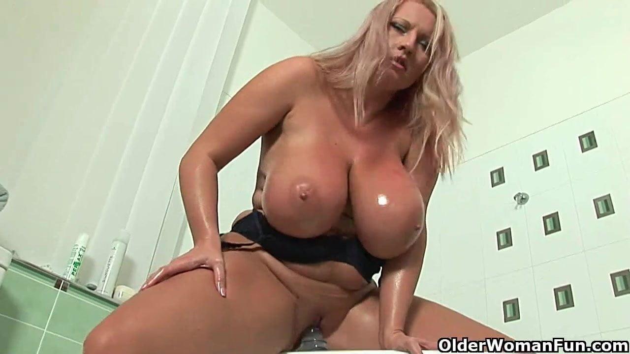 Mature with big tits fucks a dildo