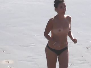 small tits mother brunette on the beach in sunset