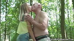 Skinny young babe fucks grandpa in nature before eating cum