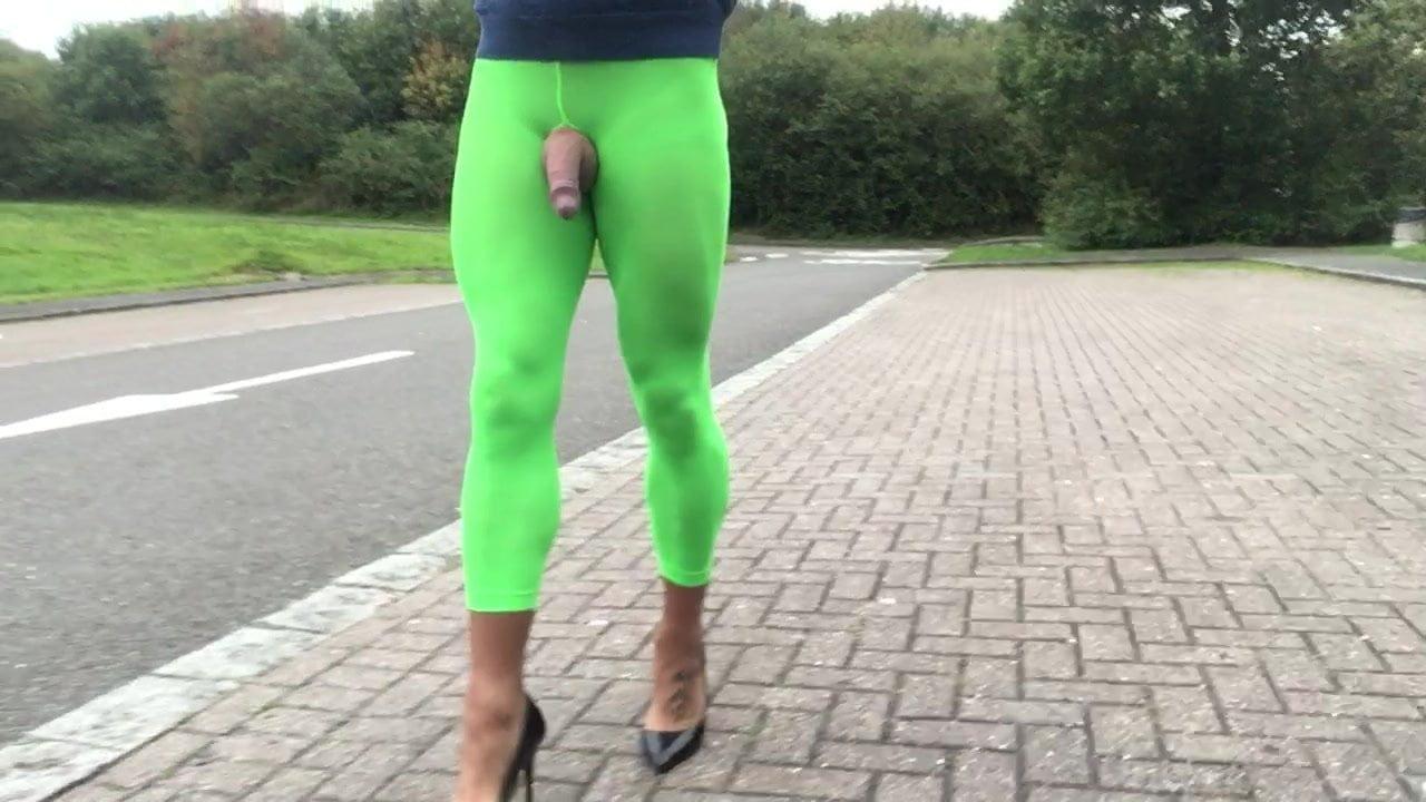 Public highway strolling in inexperienced leggings.