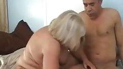 Pregnant milf oils her massive tits