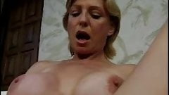 Busty mature fisted in pussy and ass by her girlfriend