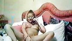 Hidden cam catches my mom masturbating at telephone