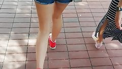 Candid Teen Walking in Blue Short on the Street City (2)