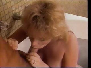 Man fucks mature blonde woman in bathtub