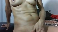 Milf plays with her pussy with fingers and toy