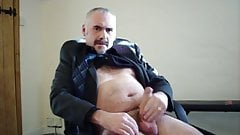 Suit daddy bear jerking his cock
