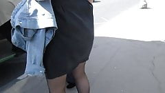 Black stockings with red tops upskirt on a bus stop