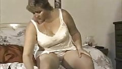 Chubby blonde fixing her stockings
