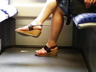 mature feet with blue toenails in train