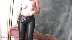 Naked babe with hot curvy body puts on tight leather pants