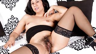 American milf Vivi needs to rub her hairy pussy