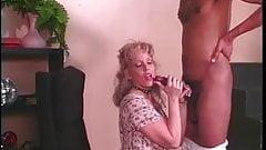 Mature blonde whore sucks an enormous black pole then fucks