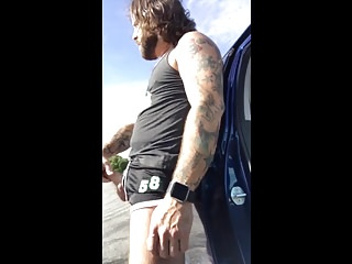 Bearded eats cum in public after he's playing with his dildo