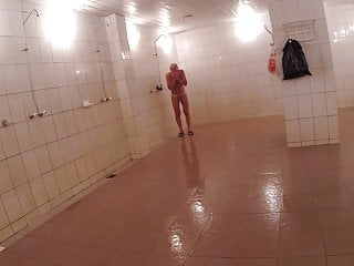 Spy cam. Man take a shower after swim in public pool naked.