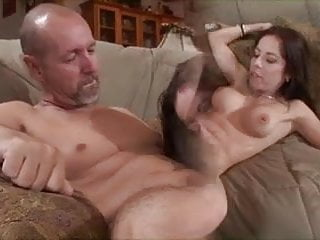 Brunette beauty gets her tight pussy filled with cock as her husband looks on